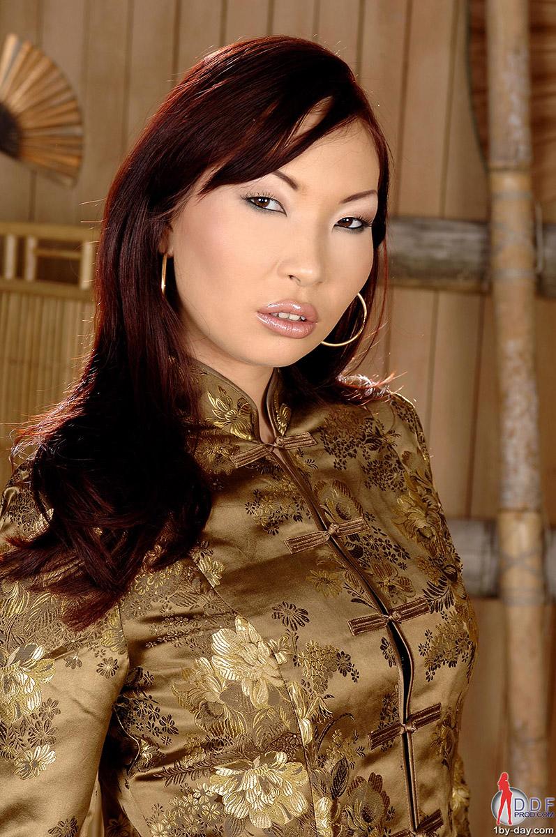Aisha Sun Sexy Eurasian Vixen Strips in Bamboo Bedroom