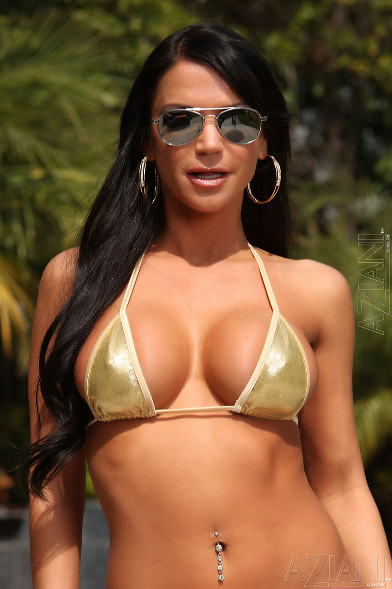 Rebecca Rayann Busty Brunette in Shades Flashes Serious Rack
