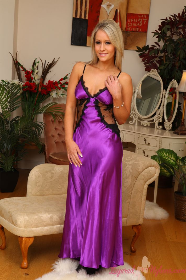 Beautiful blonde Candice in purple silk gown