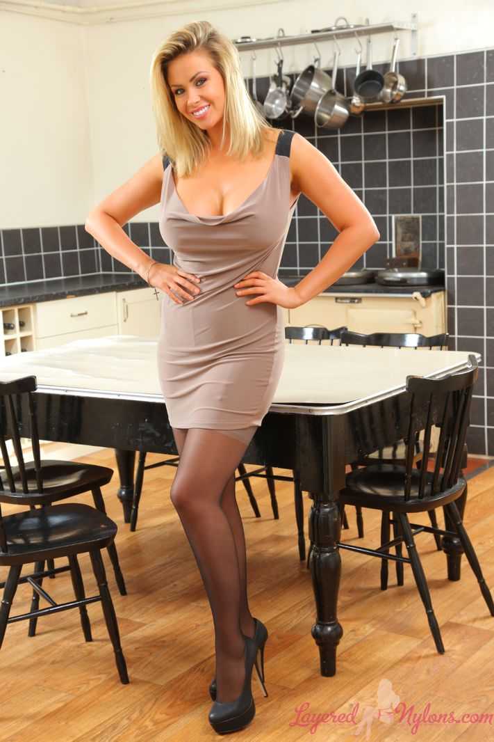 Busty blonde Leah in black pantyhose and white stockings