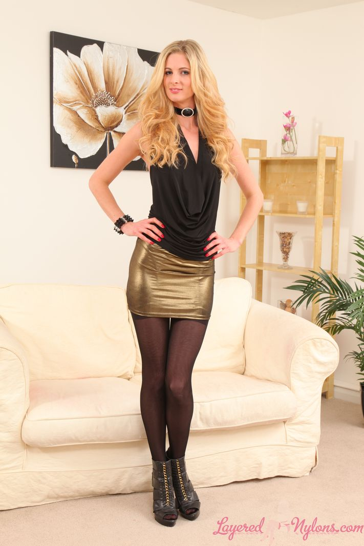Leggy blonde in black layered stockings and tights