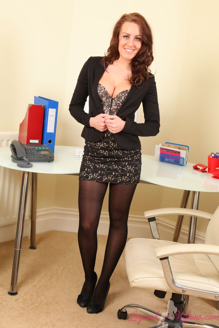 Redhead secretary in layered nylons