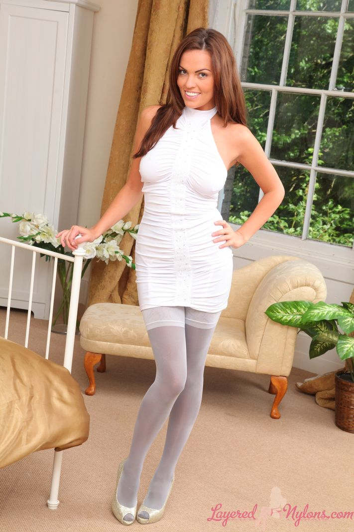 Stunning brunette in tight dress and layered legwear